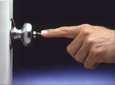 Static Electric Spark Jumps From Finger To Doorknob